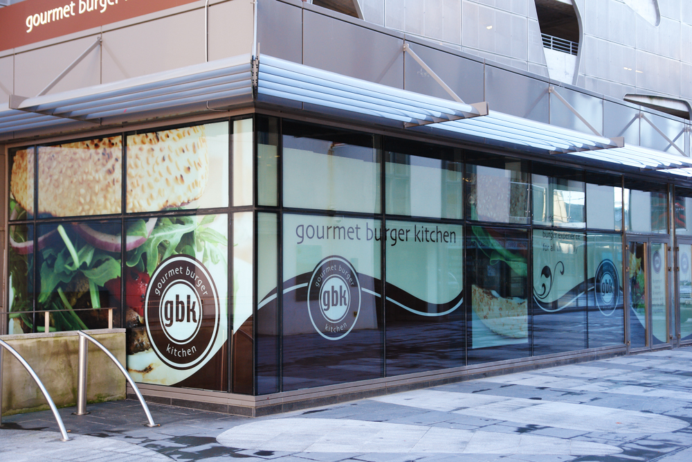 Branded window graphics printed to showcase your business for Window graphics